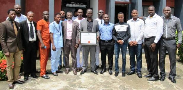 Professor Owan Enoh (middle) with the student union leaders after their visit