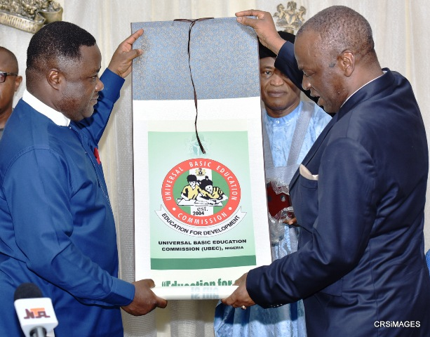 The Minister of State for Education, Professor Anthony Gozie Anwuka presenting a souvenir to Cross River State Governor, Senator Ben Ayade, during a courtesy call on the Governor in Calaba,r to the admiration of Executive Secretary, Universal Basic Education Commission, Mr. Suleiman Dikko