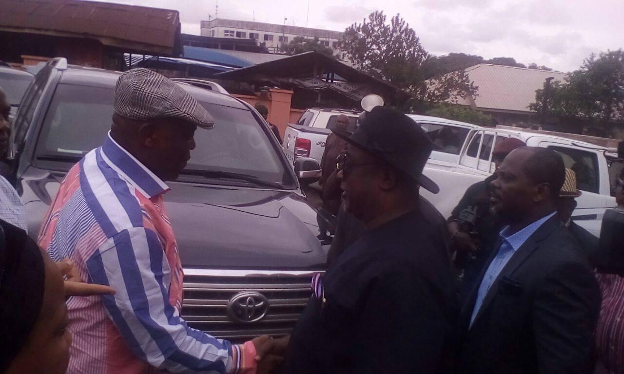 Raymond Dokpesi and Edim Inok shake hands shortly before Dokpesi's departure