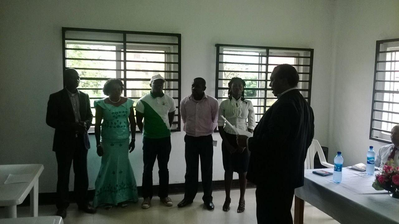 Bishop Mike Okom swearing in the executives