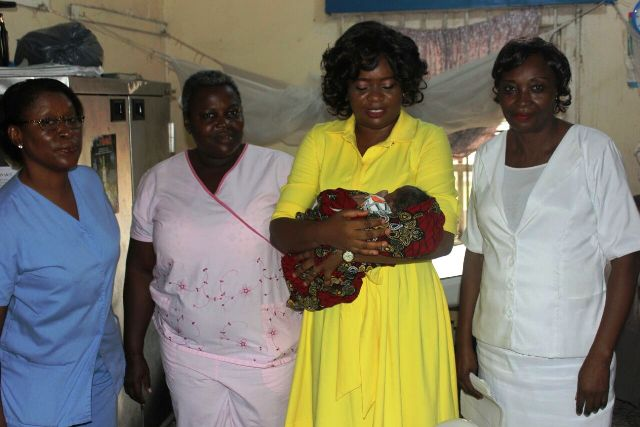 Commissioner for Health, Dr. Inyang Asibong and the midwives who delivered one of the babies