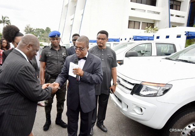Deputy Governor of Cross River State, Prof. Ivara Esu handing over keys of the vans recently donated by the state to support Special Courts operation to its Chairman, Justice Maurice Eneji in Calabar while the Chief of Staff, Hon. Martins Orim watches on