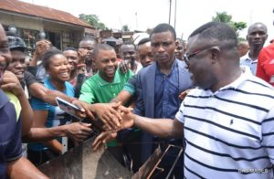 Ayade in a handshake with Cross Riverians