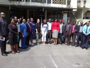 Attendees pose for a photograph after the meeting at the Ministry of Health headquarters