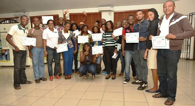 Archibong Jeremiah (Second Row, 1st from left) and other participants brandishing their certificates at the end of the training