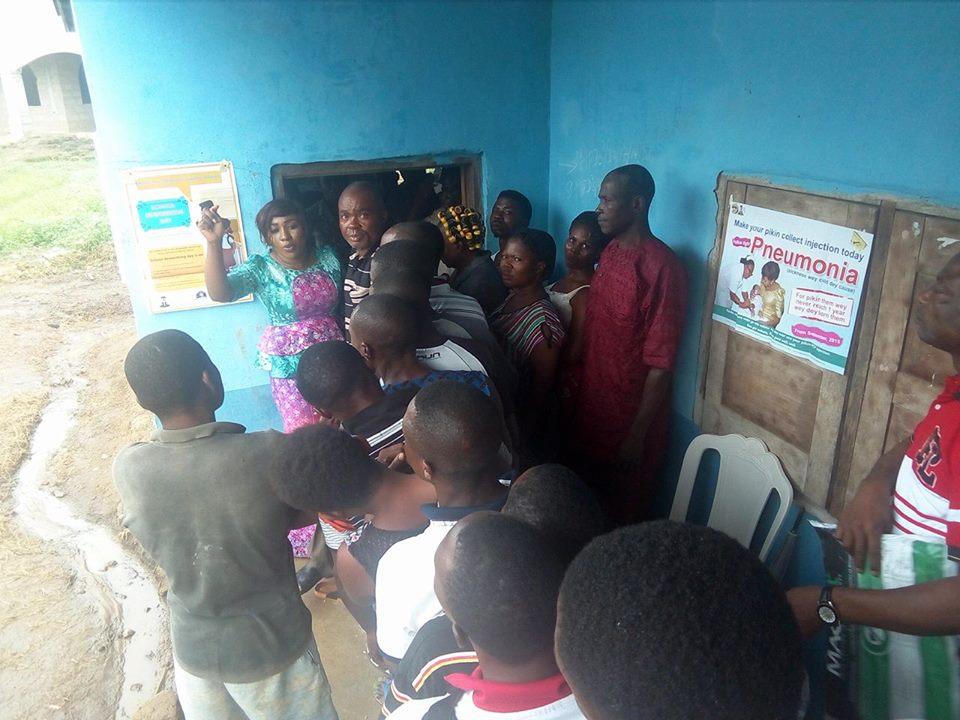 Betta Edu (In Purple) sensitizing people in Ajere health post in Mkpani, Yakurr LGA