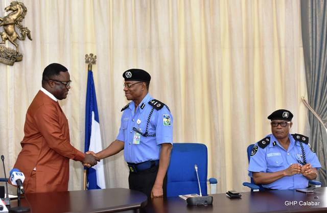 From (L) Cross River State Governor, Senator Ben Ayade, in a handshake with the (M) Assistant Inspector General of Police (AIG) Zone 6 Command Calabar, Mr. Abubakar Marafa, while the State Commissioner of Police, Jimoh Ozi-Obeh watches