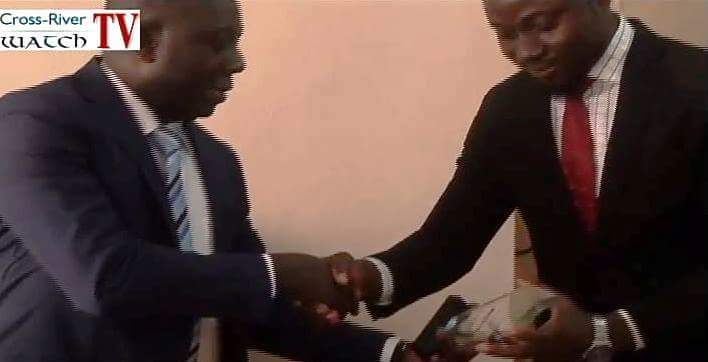 Stephen Odey(left) receiving an award from Enome Amatey (right)