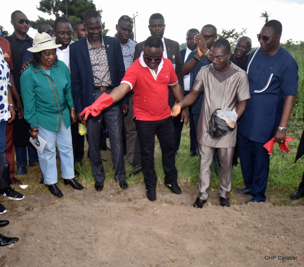 Governor Ayade planting the first rice grains