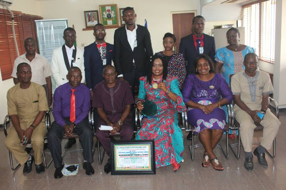 Dr Inyang Asibong flanked by staff and ASUP delegates displaying her award and medal of honor