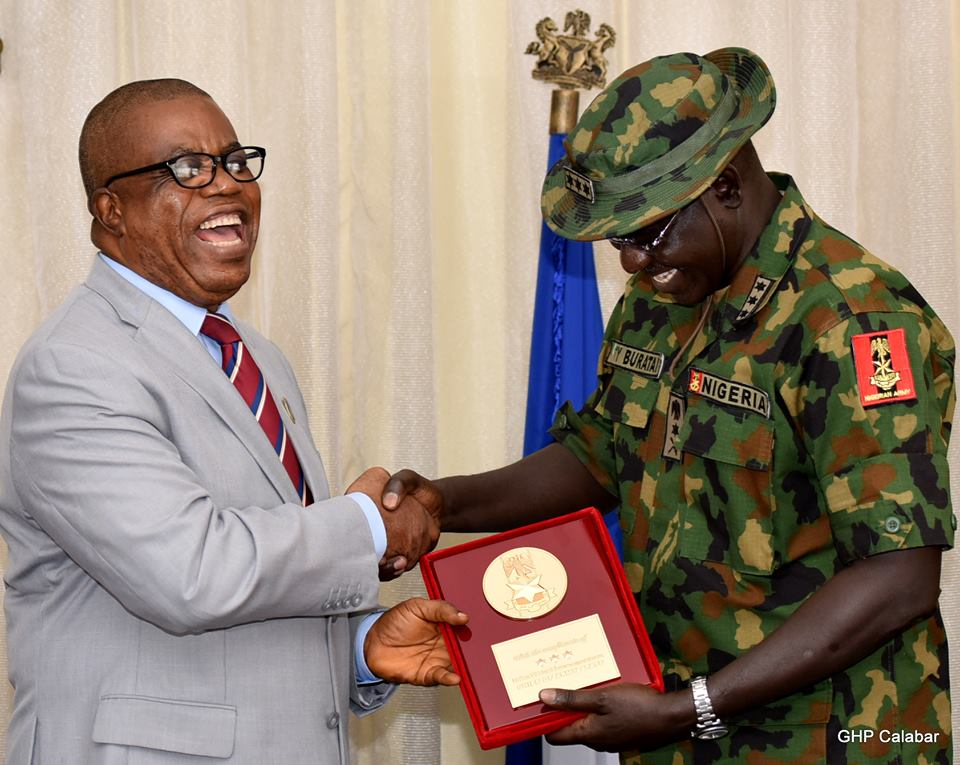 From L-R: CRS Dep Governor, Prof Ivara Esu and Chief of Army Staff Lt Gen Tukur Buratai laugh on a joke while shaking hands, Wednesday