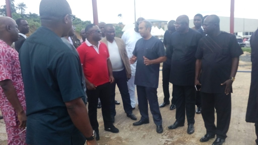 Governor Ayade (In Red) listening to the MD/CEO Dana Group of Companies Plc Jacky Hathiramani at the Calapharm site