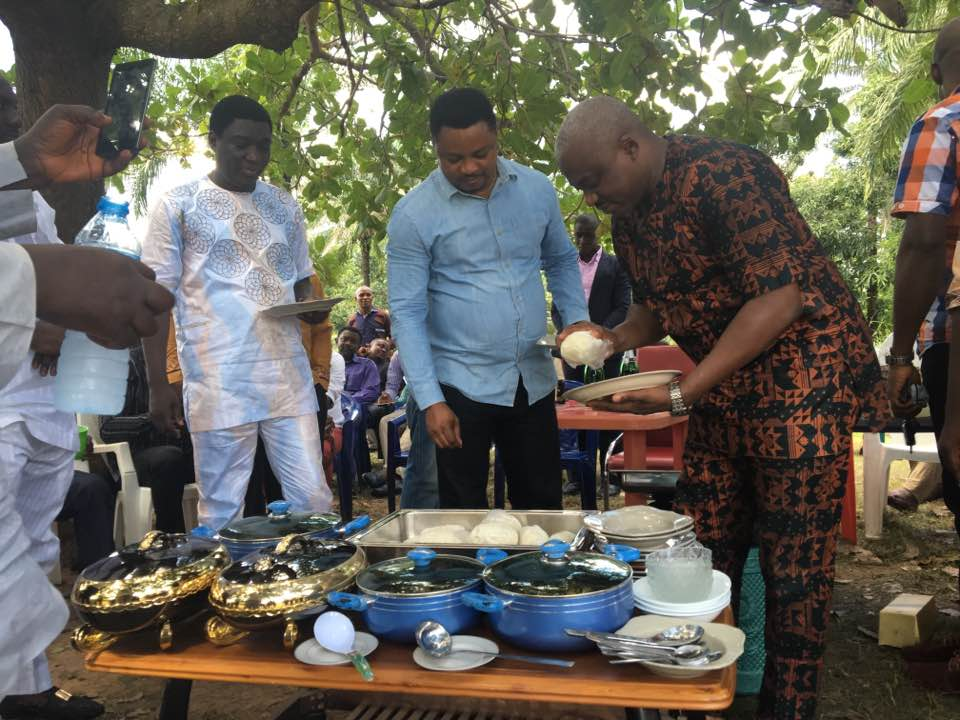 Legor Idagbo and Martins Orim sharing food with constituents (Photo Credit: Facebook/Legor Idagbo)