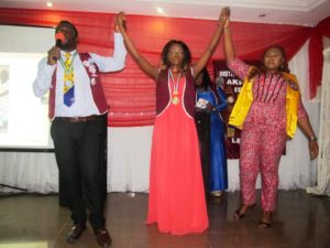 Akpabuyo Island Leo Club President (middle) being presented to members