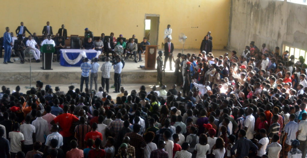 addressing the students