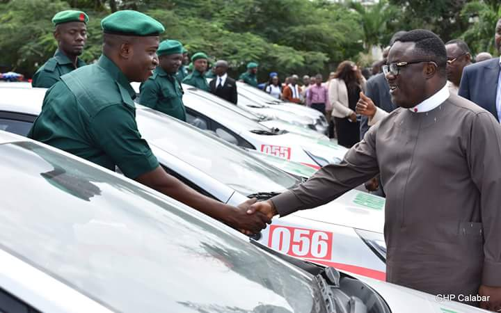 Governor Ben Ayade shakes one of the cadets after presenting them with keys to the vehicles, Friday. (Photo Credit: Govt House Calabar/Dan Williams)