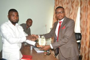 The award presentation in his office at the Assembly complex