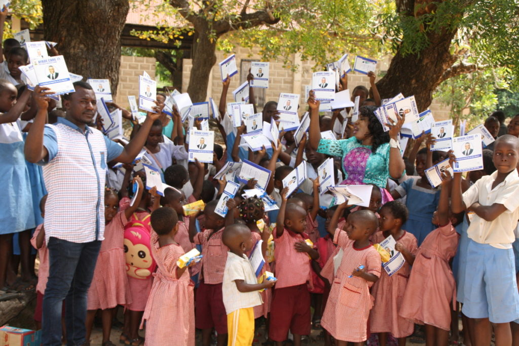 Pupils waving books received