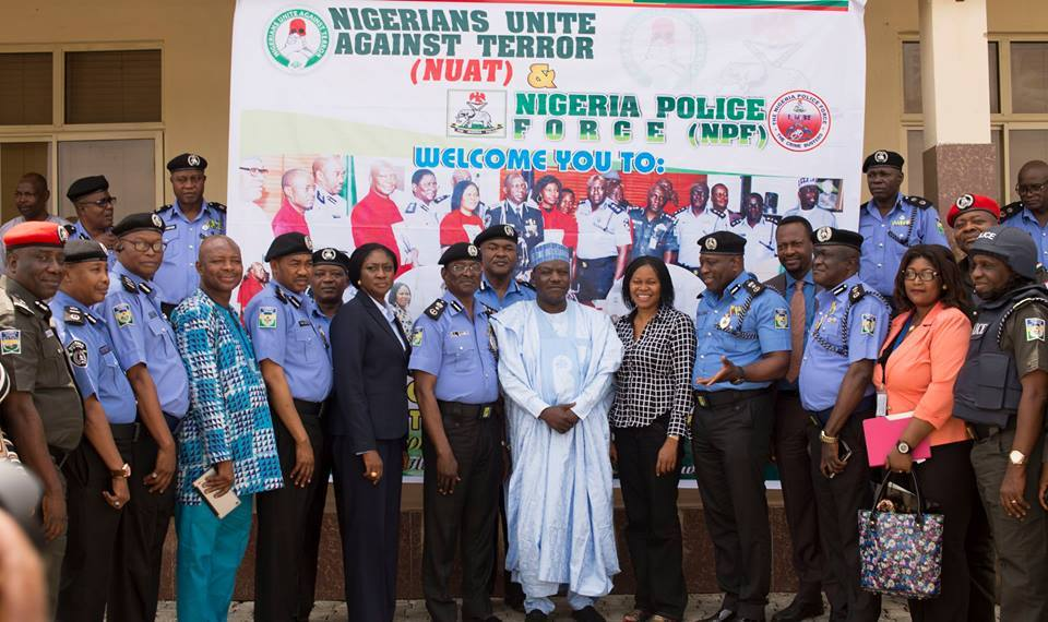 Dr. Joe Okei-Odumakin poses for a photograph with Police officers after a training session (Photo Credit: NUAT)