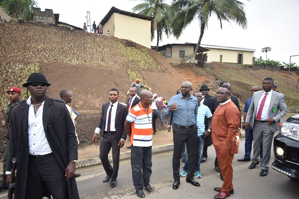 Governor Ayade getting a briefing from the Urban Renewal Chairman, Uko Inaku on the progress of work