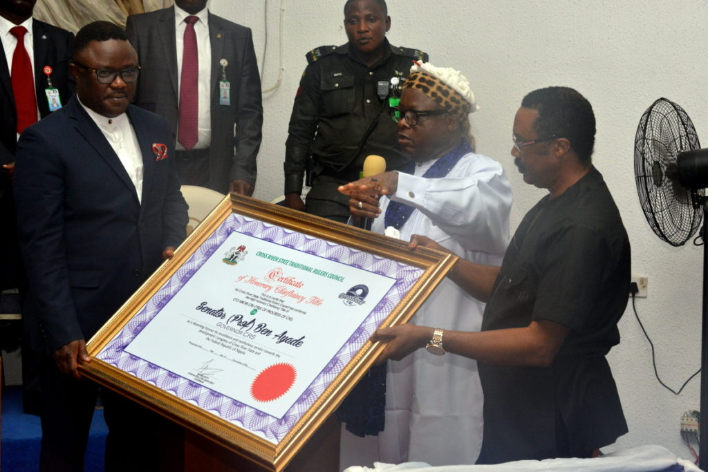 Governor Ben Ayade (L) receiving the certificate of chieftaincy from his Special Adviser Chieftaincy affairsJohn Eyikwaje (R) while Chairman Traditional Rulers Council Etinyin Etim Edet (middle) looks on
