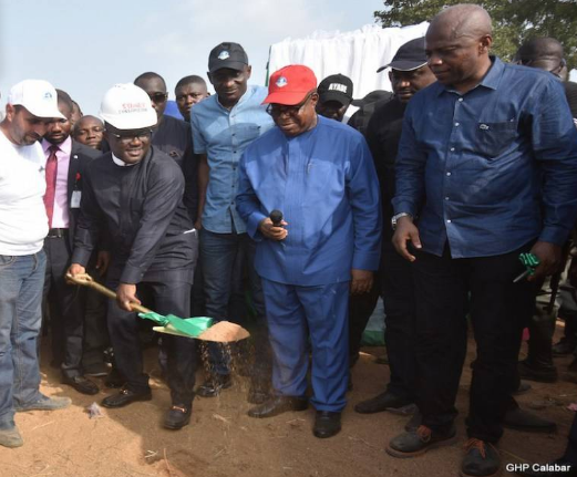 Governor Ayade performing groundbreaking for the construction of a road project in northern Cross River state while his Deputy and Works Commissioner watch on