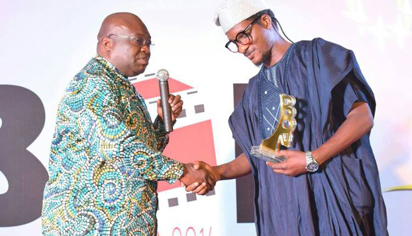 Mr Fidelis Duker, receiving his award from the Abia State Governor, Okezie Ikpeazu width=