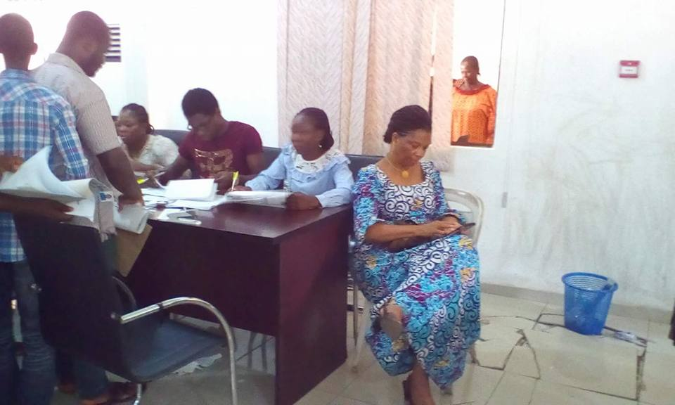 Npower Coordinator in Cross River, Ambassador Nkoyo Toyo (sitting right) while the verification exercise goes on at Calabar municipal council