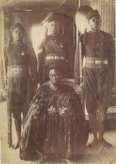This photograph shows Oba Ovonramwen (ruled 1888–1897), with guards on board the Niger Coast Protectorate yacht, SY Ivy, on his way into exile in Calabar in 1897. The once belonged to Tom Singleton Gardner, an agent for the British trading company, The Africa Association Ltd, who lived in Calabar, from around 1890 to 1917.