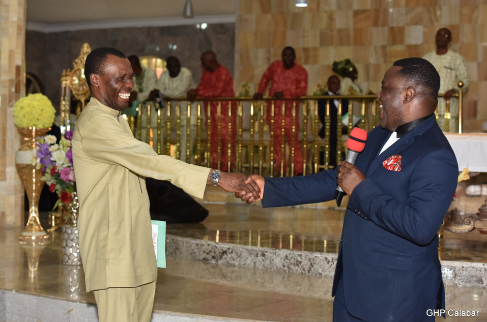 Governor Ayade in a handshake with the Niger Delta Affairs Minister, Usani Usani at the thanksgiving service in Calabar