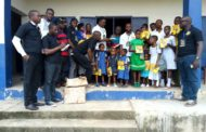 Pan African Organization Donates Items To Boost Education, Health And Crime Fighting In Cross River