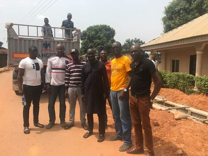 Rep Jarigbe Agom poses with members of his constituency shortly after an inspection of projects he attracted. Credit: Facebook/Roy Akpak