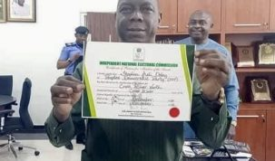 Dr. Stephen Odey displays his certificate of return as winner of the December 5, 2020 senatorial by-election in Cross River North, INEC