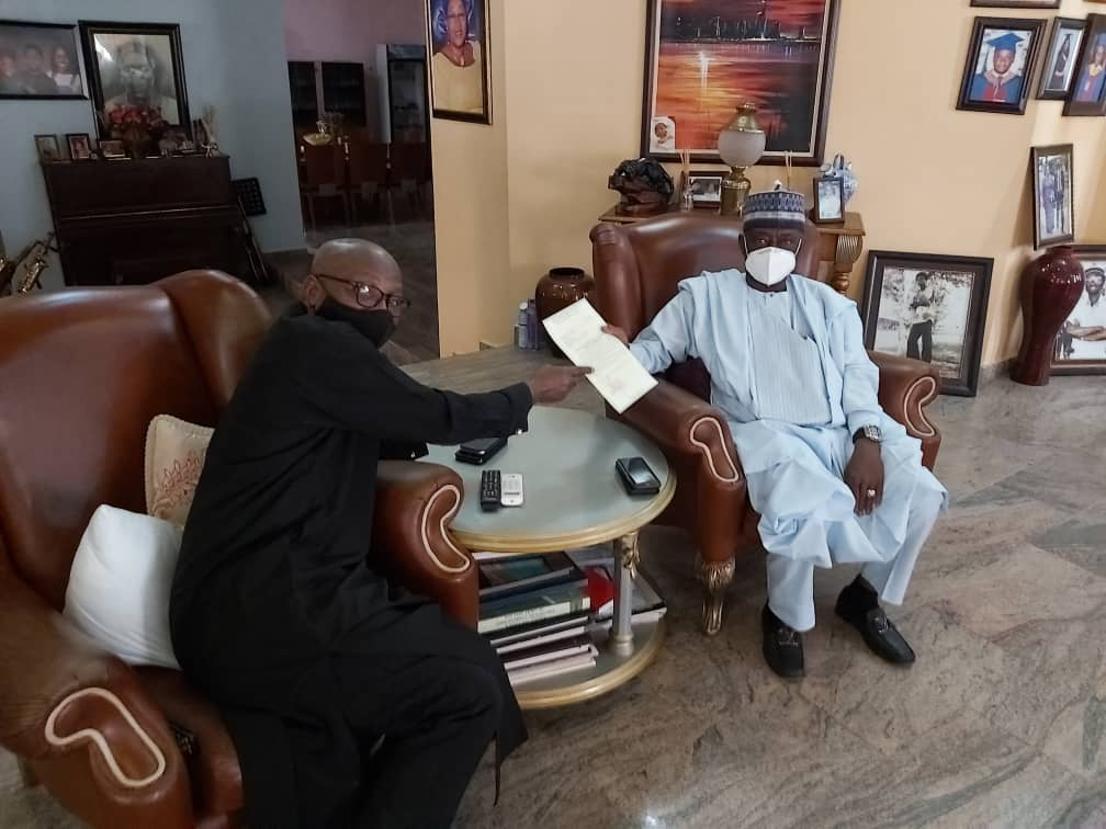 Former Director General of the State Security Service (SSS), Ekpenyong Ita Jr (L) submits a letter seeking the introduction of flights to Calabar, the Cross River State capital to Max Air limited Chairman, Alhaji Dahiru Barau Mangal (R). January 2021.