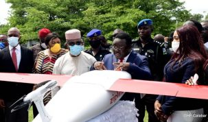 An excited Governor Ben Ayade of Cross River (in blue suit) discusses with his deputy, Professor Ivara Esu (in white) and others shortly after the signing of a Memorandum of Understanding between the State and Zipline, an American drone delivery service company for the procurement of drones to deliver medical essentials to hard to reach areas at the Governors Office in Calabar. Monday May 10, 2021. (Credit: GHP/Dan Williams)