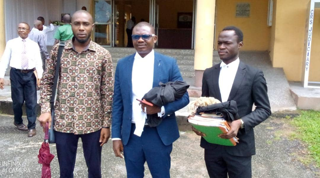 From L-R: CrossRiverWatch Managing Editor, Jeremiah Archibong, James Ibor Esq and Kehole Enya Esq walk out of the High Court of Justice complex in Calabar on October 6, 2021 after a libel and defamation suit brought by the Cross River State Government against CrossRiverWatch and Agba Jalingo stalled due to the absence of the Government's witness. (Credit: CrossRiverWatch/Jonathan Ugbal)